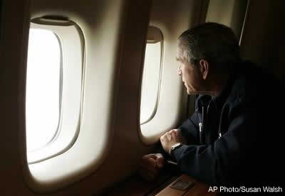 President Bush looks out the window of Air Force One inspecting damage from Hurricane Katrina while flying over New Orleans en route back to the White House, Wednesday, Aug. 31, 2005. AP Photo/Susan Walsh