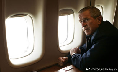 President Bush pauses after having a look from the window of Air Force One of the damage to New Orleans from Hurricane Katrina. AP Photo/Susan Walsh