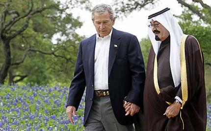 President George W. Bush holds hands with Saudi Crown Prince Abdullah