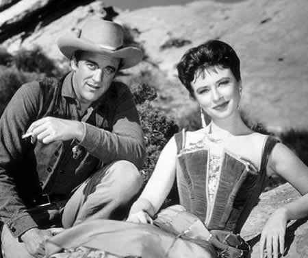 James Arness and Amanda Blake from Gunsmoke, 1956. MPTV.net