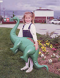Girl holding Sinclair Oil blow-up dinosaur