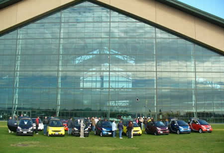 smart cars in front of the Spruce Goose